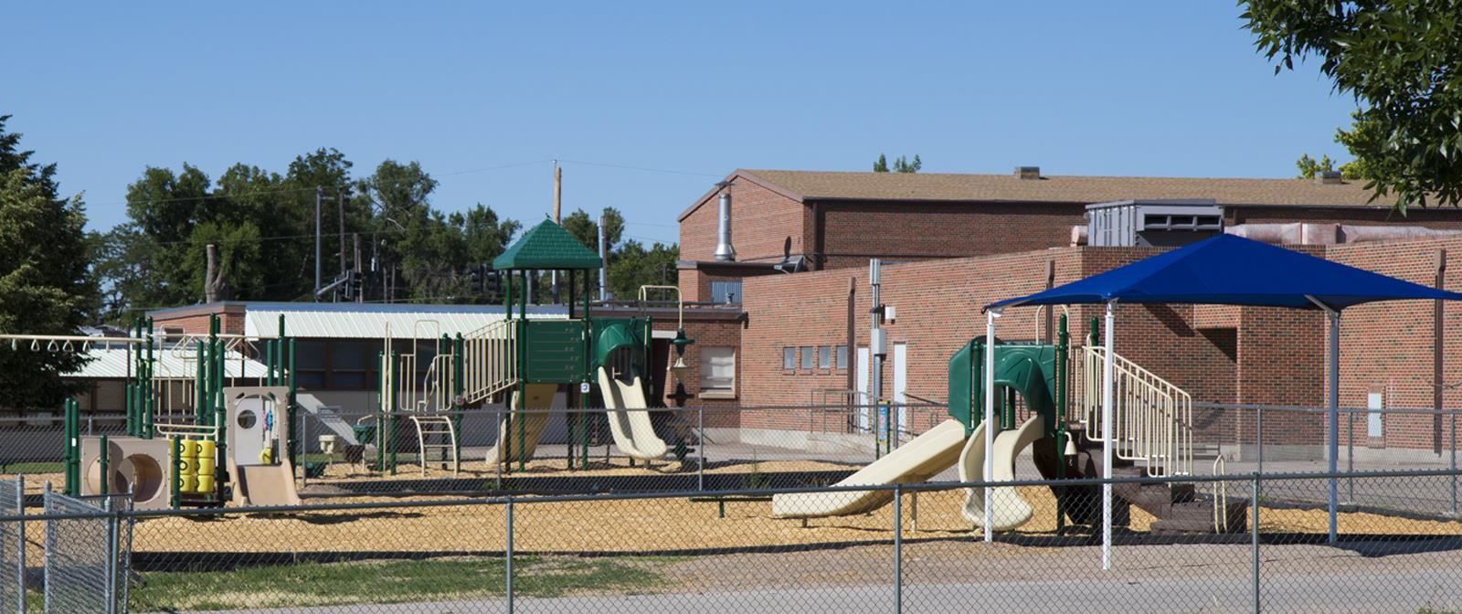 Outside of Beulah Heights school with playground on the side of the school
