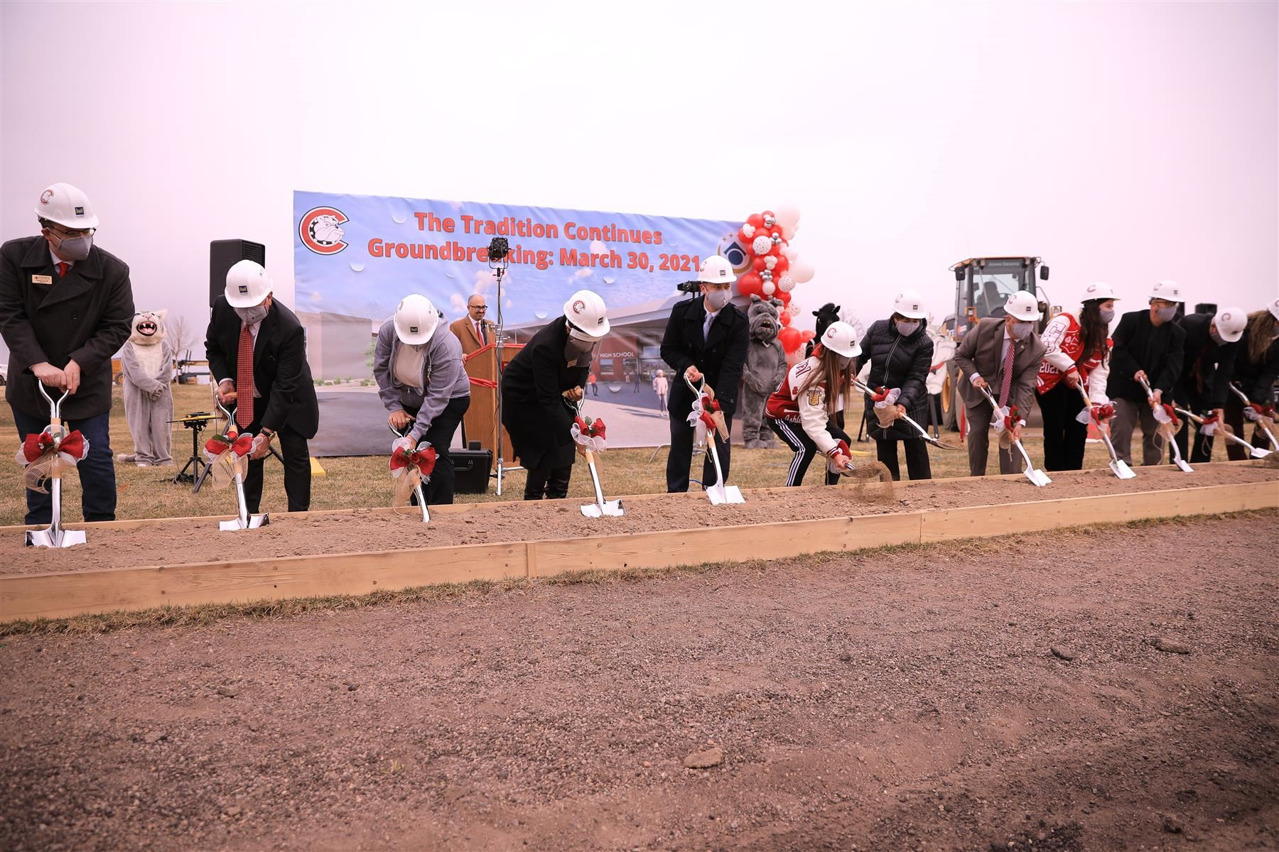 Honored guests turn dirt at the groundbreaking ceremony for Centennial