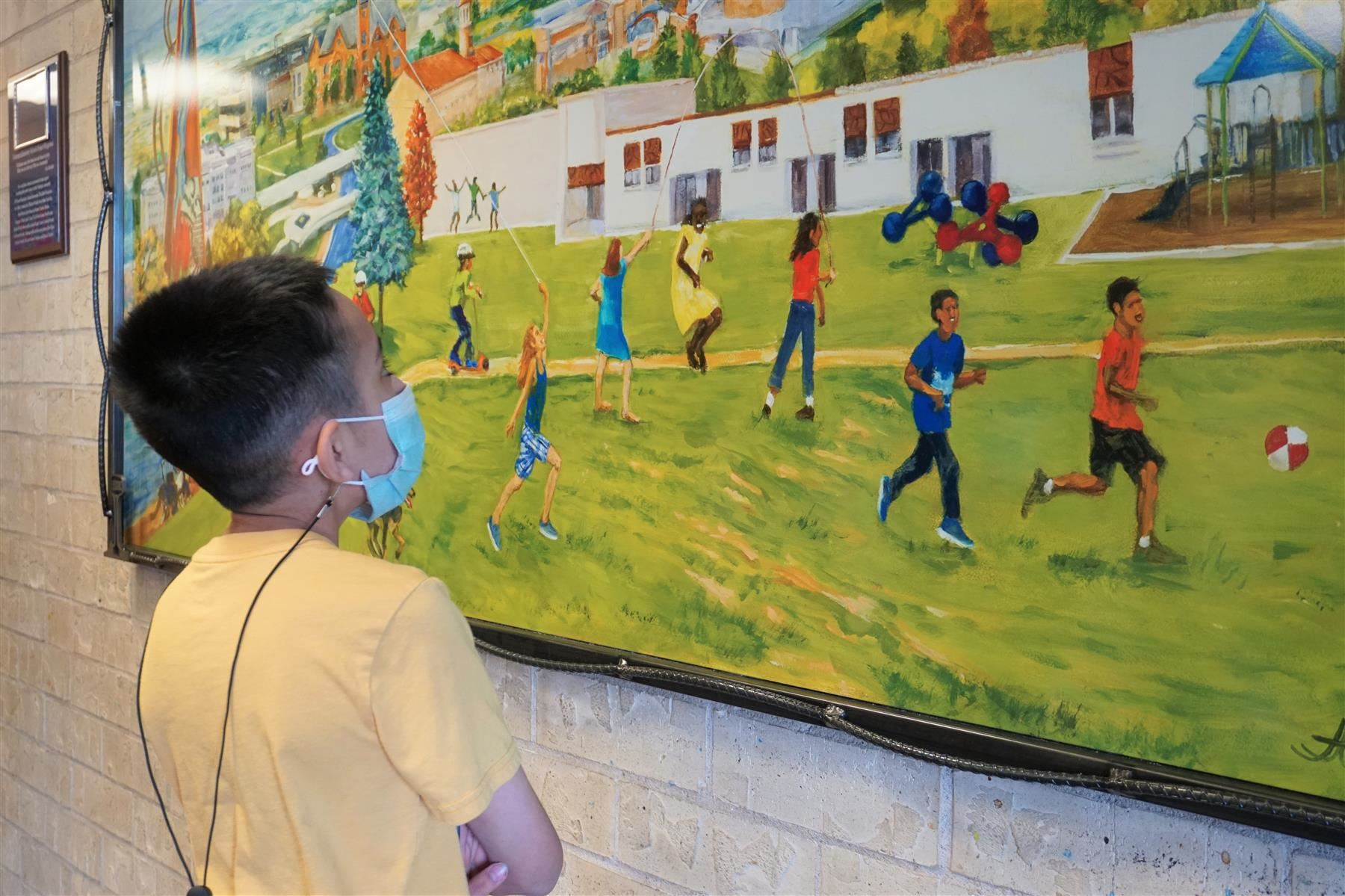 A student stops to look at Minnequa's new painting