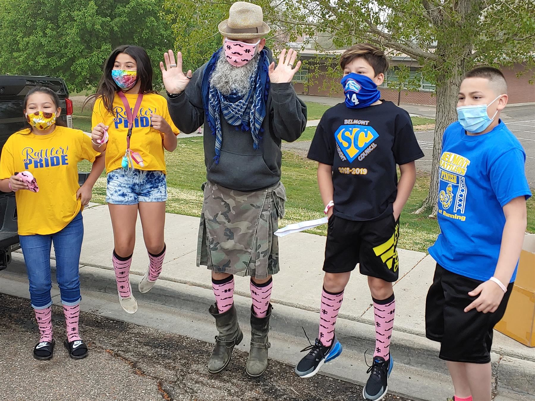 Pinksocks Founder Nick Adkins shows off his pink socks with a group of Belmont students